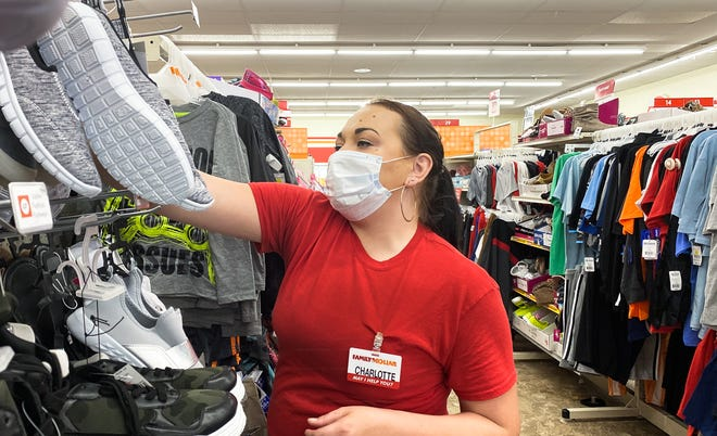"""""""The company has been great, we've got masks and gloves, and have protective barriers at checkout lanes,"""" Charlotte Argento says Monday, April 27, 2020, while on her shift at Family Dollar in Lansing.  """"People need to know though that they're putting others at risk by not wearing masks, or getting too close to people,"""" the mother of four said."""