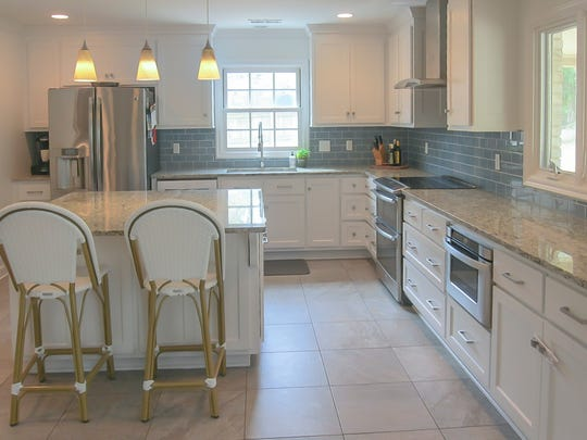 The kitchen in the East Memphis home was already renovated. The large island offers storage and seating for casual dining.