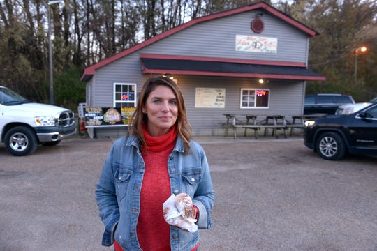 """Vivian Howard stands outside Helen's Bar BQ in Brownsville, Tenn., for the barbecue episode of """"Somewhere South."""""""