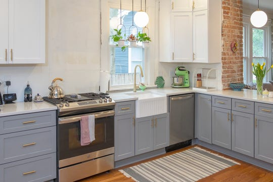 The renovated kitchen is much larger than the original in  this Midtown home. All new cabinets, countertops, and appliances give a modern look to the 100-year-old space.