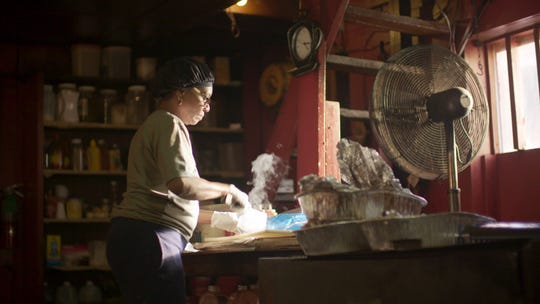"""Pitmaster Helen Turner prepares a customer's order at her restaurant, Helen's Bar BQ in Brownsville, Tenn. Turner appears in the barbecue episode of """"Somewhere South,"""" airing at 8 p.m. May 1 on WKNO."""