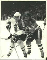 Buzz Schneider (left) was a player for the Milwaukee Admirals before scoring in the great 'Miracle on Ice' game.