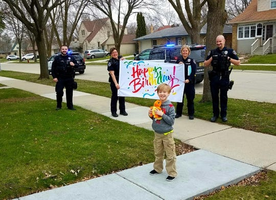 Greyson Lawson celebrated his eighth birthday with Glendale police officers April 24. In lieu of birthday parties, Glendale and other local police departments are helping kids celebrate from a distance during the coronavirus pandemic.