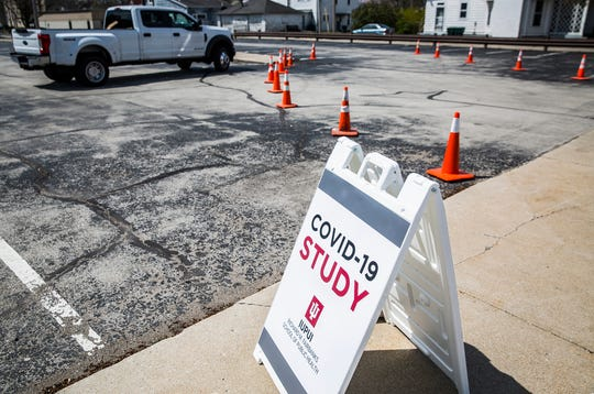 The Ivy Tech parking lot at 345 S. High Street is sectioned off on the third day of IUPUI's Richard M. Fairbanks School of Public Health COVID-19 testing for the Indiana State Department of Health in downtown Muncie Monday, April 27, 2020. The state wide research initiative  invites a random selection of residents from each district to register for a free, drive-thru coronavirus test which will then be used to study the spread of the pandemic locally.
