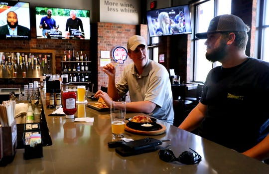 Logan Thigpen, left, and Will Nelson have lunch at Two J's Grille on Monday, April 27, 2020. Monday was the first time Tennessee restaurants were allowed to have dine-in service since being ordered to limit business in March.
