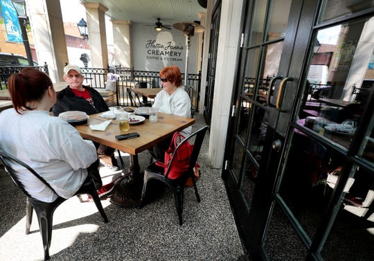 RaeAnn Chelette, left, dines with her parents, CW and Linda Davenport, on the patio at Puckett's Grocery & Restaurant in downtown Murfreesboro on Monday, April 27, 2020.