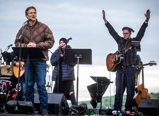 """Governor Bill Lee speaks during the """"Beyond Our Walls"""" drive-in church service hosted by Grace Chapel and other local churches at The Williamson County AG Expo Park in Franklin on Sunday, April 26, 2020."""