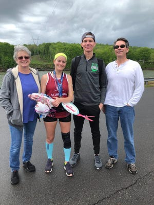 Tracie Holt, second from left, finished a full marathon Saturday, April 25, even though the Nashville Rock n' Roll race scheduled for that day was canceled because of the ongoing COVID-19 pandemic. She celebrated with (L-R) mother Cindy Cannon, husband Jesse Holt and father Barrett Cannon.