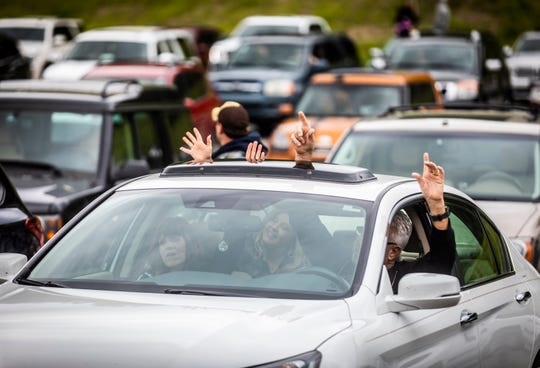 """People worship from within their cars during the """"Beyond Our Walls"""" drive-in church service hosted by Grace Chapel and other local churches at the Williamson County AG Expo Park in Franklin on Sunday, April 26, 2020."""