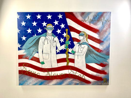 Ricky Jackson, bar manager for Lake Park Diner in Naples, created and donated this piece of art to NCH Baker Hospital in downtown Naples.