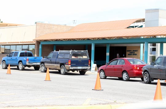 Vehicles lined up Monday, April 27,  for take-home lunches at the Deming Senior Citizen's Center, 800 S. Granite St.