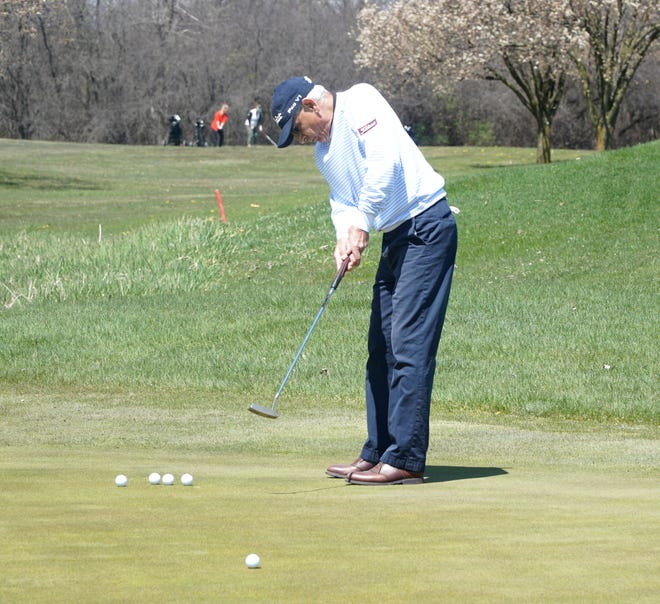 Craig Dzouigian practices on the putting green at Canton's Pheasant Run Golf Club on April 27, 2020.