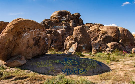 COVID-19 graffiti left on Johnson Valley rock formations.