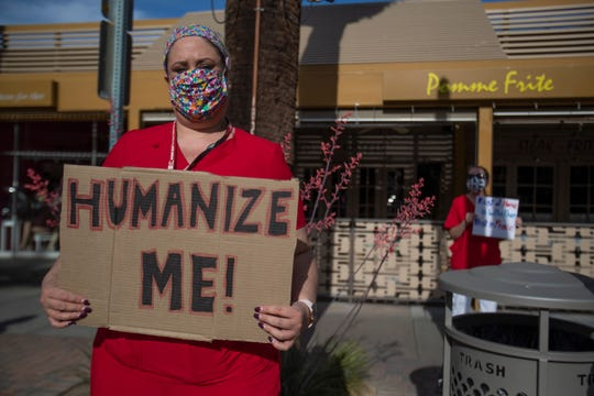 Counter-protestors to opponents of stay-at-home order congregate to express their opposition in Downtown Palm Springs on April 26, 2020. The stay-at-home order was put in place by the state government in order to prevent the spread of COVID-19 which has caused the death of over 50,000 people in the U.S. as of April 26, 2020. The opponents cite their constitutional right to an open economy.
