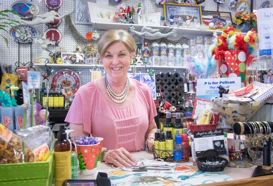 Owner Carol Campbell is optimistic that things will return to normal even though business is currently very slow at the Blue Sky Gift Shop due to the coronavirus pandemic in Gulf Breeze on Monday, April 27, 2020.