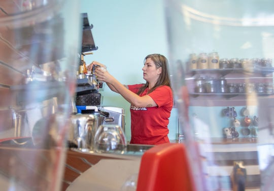 Co-owner Keri Clark prepares a drink at Pacific Kava on North Ninth Avenue in Pensacola on Monday, April 27, 2020.