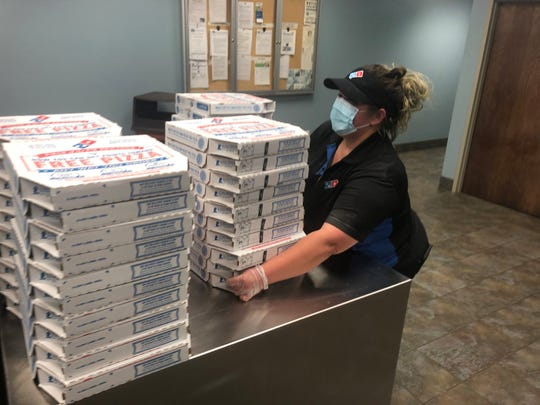 Domino's Pizza recognizes ECUA sanitation staff for cleanup efforts.