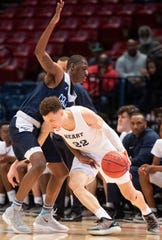 Calhoun's Jamichael Boone defends against Sacred Heart's Jayden Stone in AHSAA final four action at Legacy Arena in Birmingham, Ala. on Monday February 25, 2019.