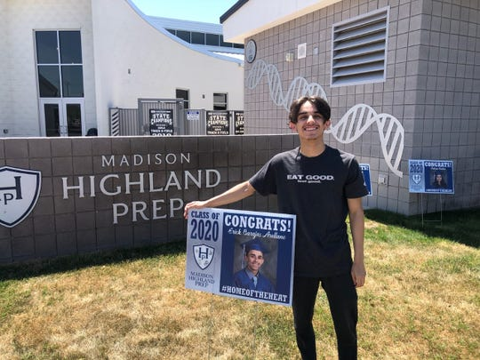 Senior, Erick Barajas, with his personalized yard sign from Madison Highland Prep