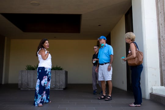 Real estate agent Christa Lawcock (left) shows off a space to perspective clients Richard Snyder and Mary Snyder at Regency Towers in Phoenix on April 24, 2020. The Snyders held masks to wear for precautions during the COVID-19 pandemic.