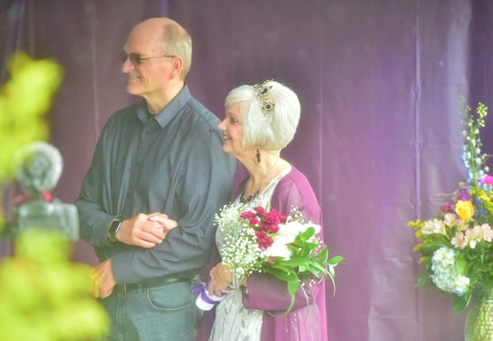 AfterBob Vizthum and Layne Miller's original plans for a May wedding fell through due to coronavirus-related cancellations, the two pastors decided to live-streaed a small front-yard ceremony for hundreds of friends and families to watch on Facebook.