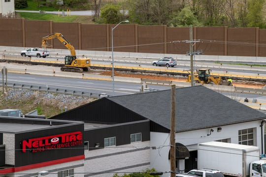 An excavator works between north and southbound lanes of Interstate 83 near the Mount Rose exit on April 27, 2020. Crews resumed working at the site on April 15 after being shut down because of the novel coronavirus.