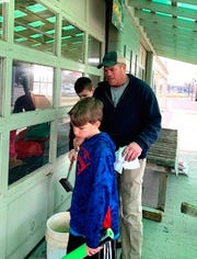 Courtland May, 13, and brother Henry, 11, get window-washing lessons from their dad, Charlie May, at the family's Mayflowers Nursery and Garden Center in Canandaigua.