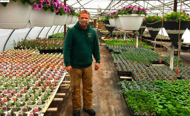 Rick Joseph is seen in the greenhouse of his family's business, Joseph's Wayside Market, in Naples, Ontario County