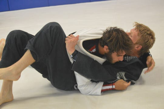 Grapplers Christian Fisher (center) and Austin Kische (right) tangle during a session at Rice Brothers Brazilian Jiu-jitsu in Redding on Monday, April 27, 2020.
