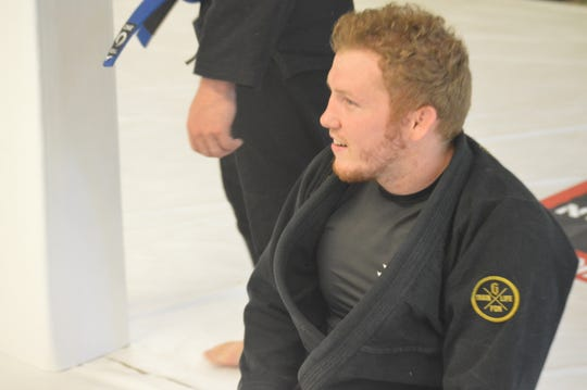 Rice Brothers Brazilian Jiu Jitsu owner Tanner Rice looks on during a class after deciding to reopen his gym on Monday, April 27, 2020.