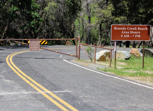 A gate blocks Brandy Creek Beach at Whiskeytown National Recreation Area on April 24, 2020. The popular beach was set to reopen Wednesday afternoon, June 17, 2020, after an algae bloom earlier in the week.