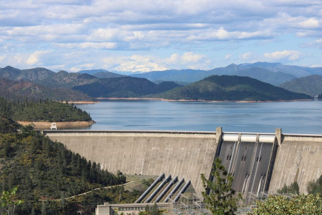 Visitors can see Mount Shasta in the distance over Lake Shasta and the Shasta Dam on Friday, April 24, 2020.