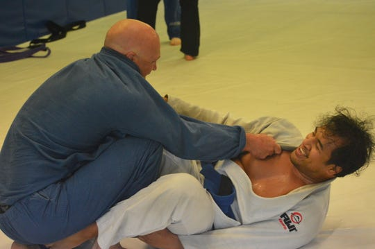 Grappling student Isaia Faumui, 32, and Travis Nicolay, 40, clinch each other's gi during a class at Rice Brothers Brazilian Jiu Jitsu in Redding on April 27, 2020.