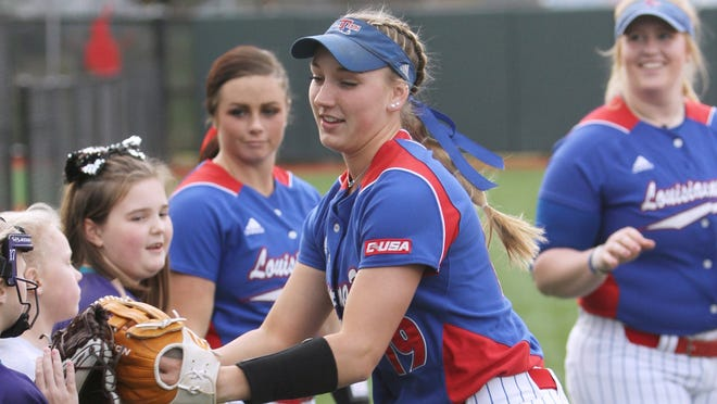 Lady Techster's shortstop Bayli Simon greets youngsters at a game.