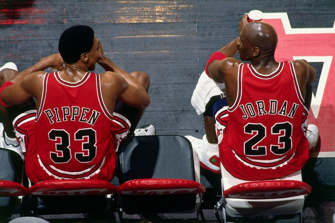 Scottie Pippen #33 and Michael Jordan #23 of the Chicago Bulls sit on the bench during the game against the Vancouver Grizzlies at General Motors Place on January 27, 1998 in Vancouver, British Columbia, Canada. (Copyright 1998 NBAE)