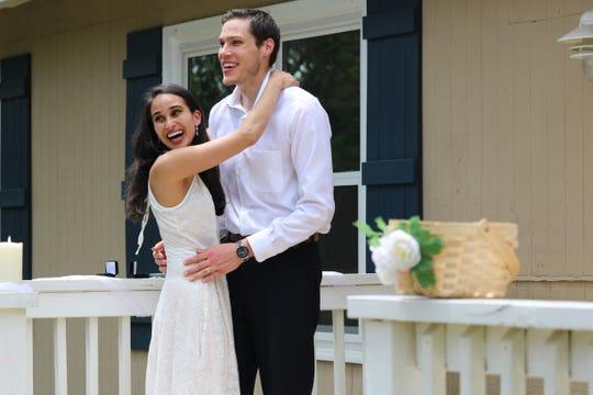 Jason Khan-Hohensee and Yasmin Khan-Hohensee at their April 18 wedding at their home.