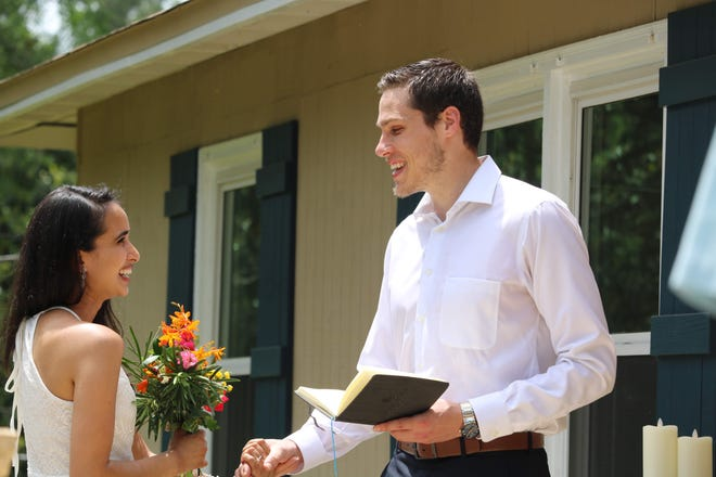 Jason Khan-Hohensee and Yasmin Khan-Hohensee are married at their home on April 18 in the Indianhead Acres neighborhood.