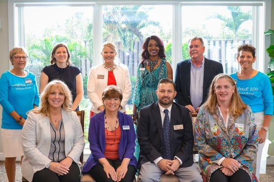 Representatives of the nonprofit agencies selected as winners and merit award winners for the 2020 Impact 100 grants in Indian River County, along with Impact 100 representatives, are: Seated, from left to right: Judith Cruz, Treasure Coast Food Bank; Dr. Edie Widder, ORCA; Tony Zorbaugh, The Source; and Heather Dales, The Arc of IRC. Standing, from left to right: Suzanne Carter, Impact 100 Grants chairwoman; Moreen Burkart, VNA Hospice; Stacey Watson-Mesley, Big Brothers Big Sisters; Sabrina Sampson, Children's Home Society; Chuck Bradley, Camp Haven; and Amy Acker, Impact 100 president.