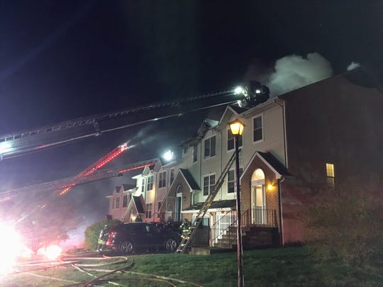 Firefighters battled a blaze at Clearview Ridge townhomes early Monday morning. No human injuries were reported, but first responders treated a cat that was saved from a burning townhome.