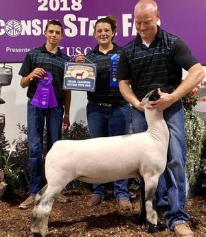 Ally Loosen is pictured at the 2018 Wisconsin State Fair with her brother, Paul, left, and mentor Ryan.