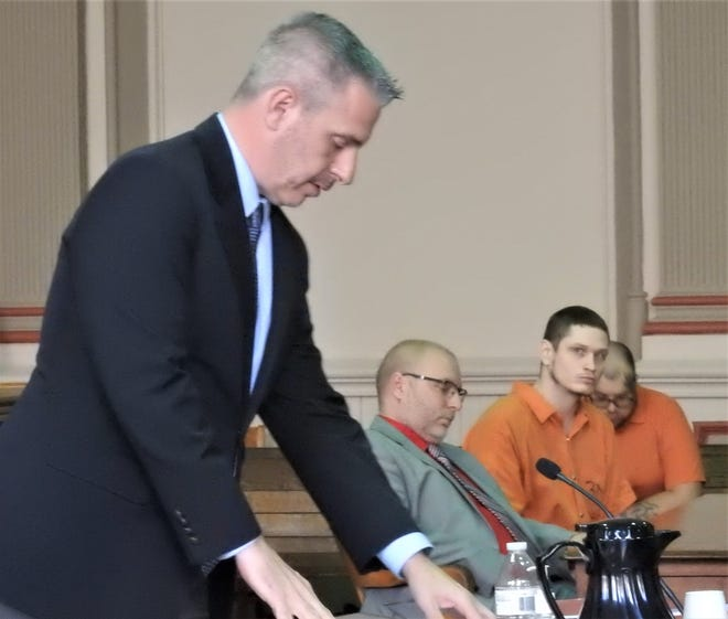 Donald Haser, represented by attorney Keith Edwards, listens as Assistant Prosecutor Ron Welch informs the court of Haser's lengthy criminal history.