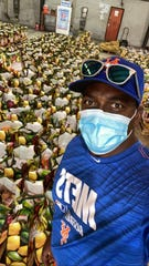 New York Mets bench coach Hensley Meulens show bags of food he has helped to assembl at a food back in his homeland of Curacao.