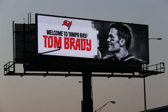 Mar 26, 2020; Tampa, Florida, USA;  Tampa Bay Buccaneers quarterback Tom Brady (12) is welcomed on a billboard over the crosstown expressway in Tampa Bay.