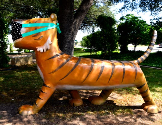 """Keeping with the times, a mask covers the face of Mr. Tiger, a 2019 sculpture based upon the book """"Mr. Tiger Goes Wild.""""  Installed in the Adamson-Spalding Storybook Garden at the Abilene Convention Center, this statue and others like it were decorated by the Abilene Cultural Affairs Council to feature in a social media post this week on keeping safe during the coronavirus crisis."""