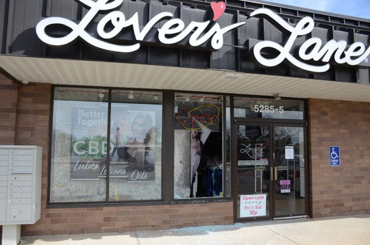 Burglars smashed a window next to the door to enter the Battle Creek Lover's Lane store.  Trace Christenson/The Enquirer
