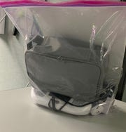 Sterilized telehealth equipment is placed in the clear bag at UR Medicine Home Care.