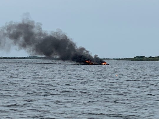 A burning boat sank Sunday afternoon in the Indian River Lagoon near Titusville.