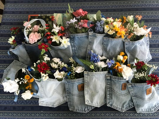 These happy recycled and resourceful denim pockets are serving as May Day greetings for 112 staff workers at Heartland of Bucyrus. It is part of an outreach effort of the Earth, Wind and Flowers Garden Club.