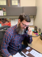 Zach Raney, epidemiology manager for Northern Kentucky Public Health, makes a phone call as part of a contact trace -- where authorities track everyone in contact with someone suffering an infectious disease.