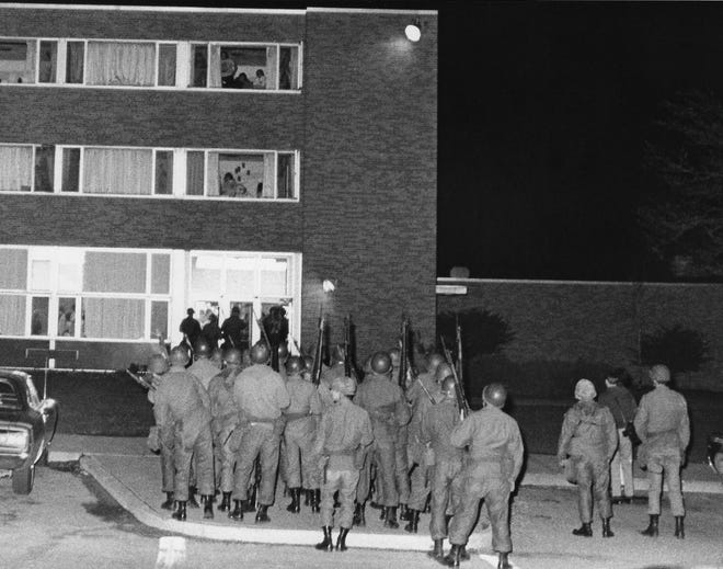 National Guardsmen stand outside a dormitory building at Kent State University on May 2, 1970, with bayonets fixed on their M1 rifles. A night of unrest on the campus would end in the ROTC building burning down, along with other vandalism.